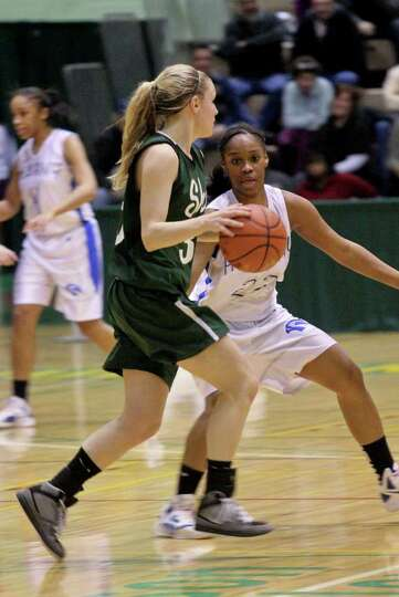 Emily Weber, of the Shenendehowa Lady Plainsmen, center, is defended by India Terrell, of the Albany