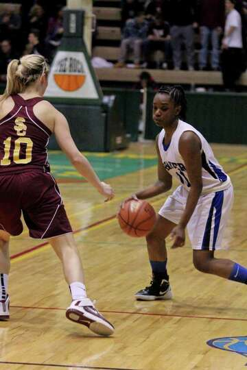 Jaclyn Welch, of the Colonie Lady Raiders, left, defends against Adriene Gambles, of the Shaker Lady
