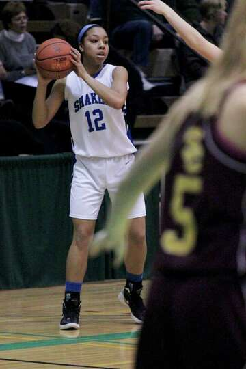 Madison Rowland, of the Shaker Lady Blue Bison, looks for an open teammate at the Class AA girls' se