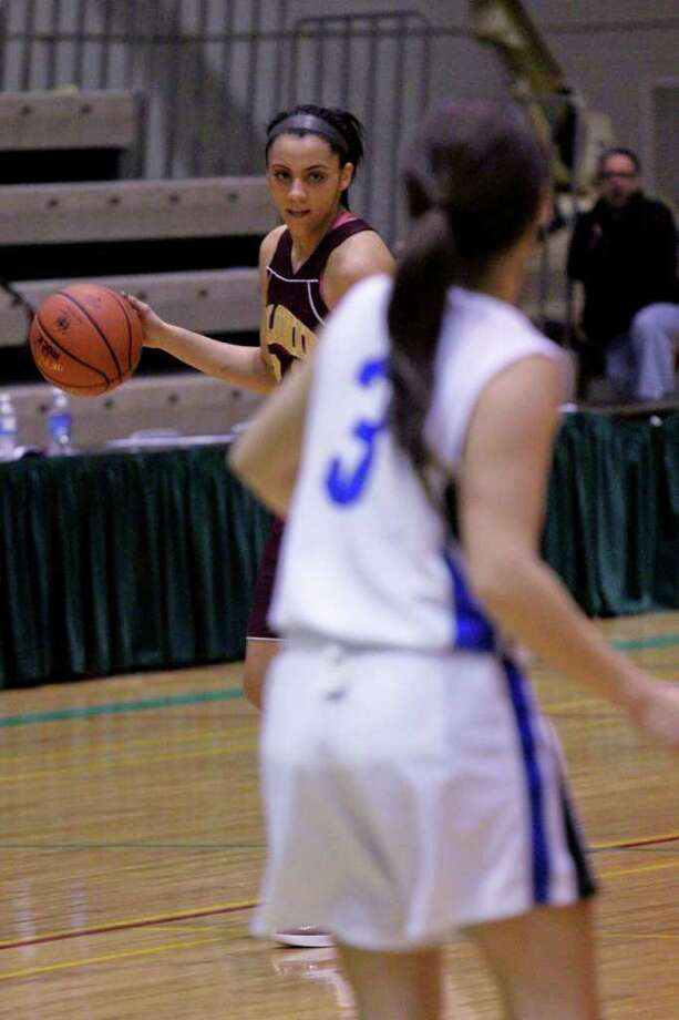 Sydney Rosales, of the Colonie Lady Raiders, rear left, stares down Erica Vallecorsa, of the Shaker Lady Blue Bison, front right, at the Class AA girls' semifinals game at Hudson Valley Community College, Troy, on Thursday, March 1, 2012. (Erin Colligan / Special To The Times Union)