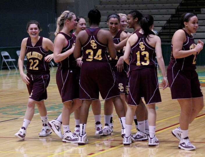 The Colonie Lady Raiders celebrate after winning a Class AA girls' semifinals game between Colonie H