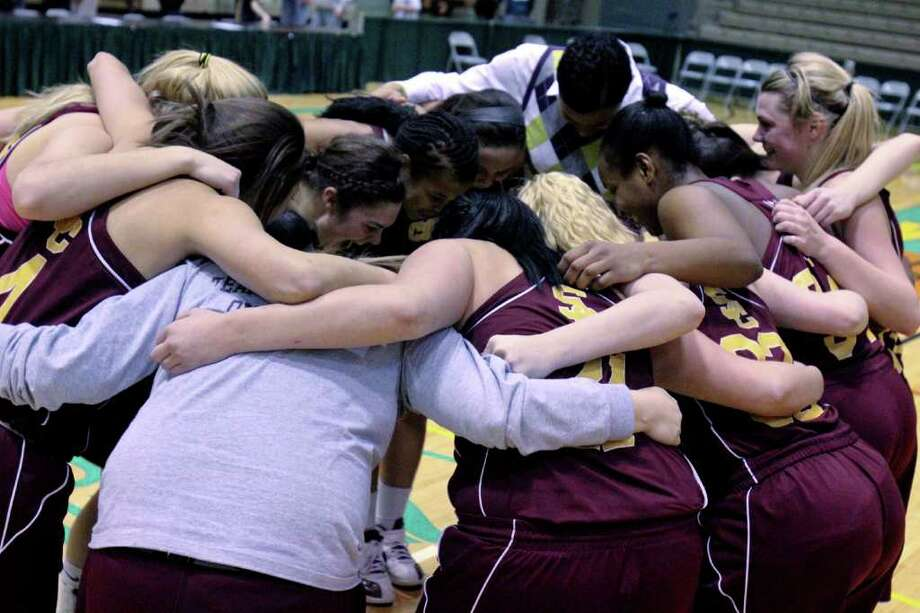 The  Colonie Lady Raiders celebrate after winning a Class AA girls' semifinals game between Colonie High School and Shaker High School at Hudson Valley Community College, Troy, on Thursday, March 1, 2012. (Erin Colligan / Special To The Times Union)
