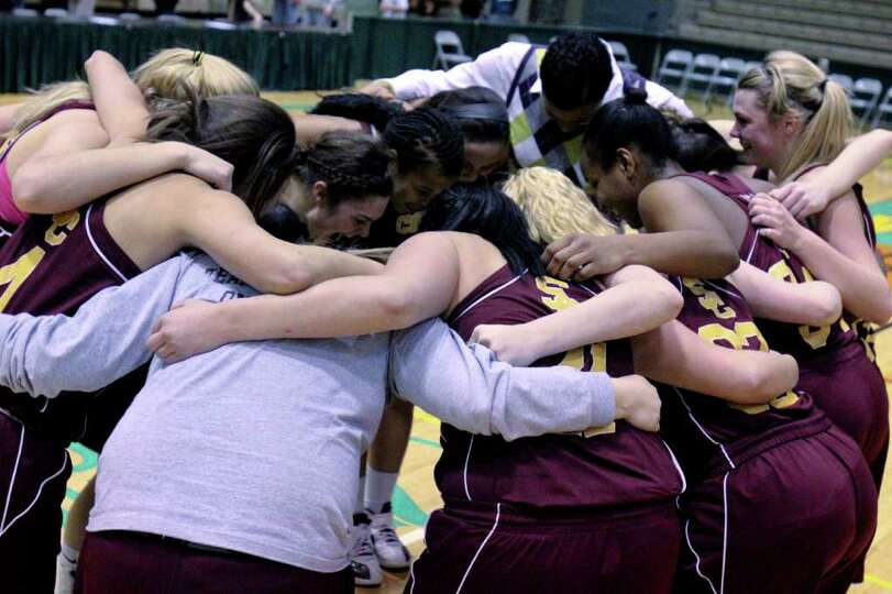 The  Colonie Lady Raiders celebrate after winning a Class AA girls' semifinals game between Colonie