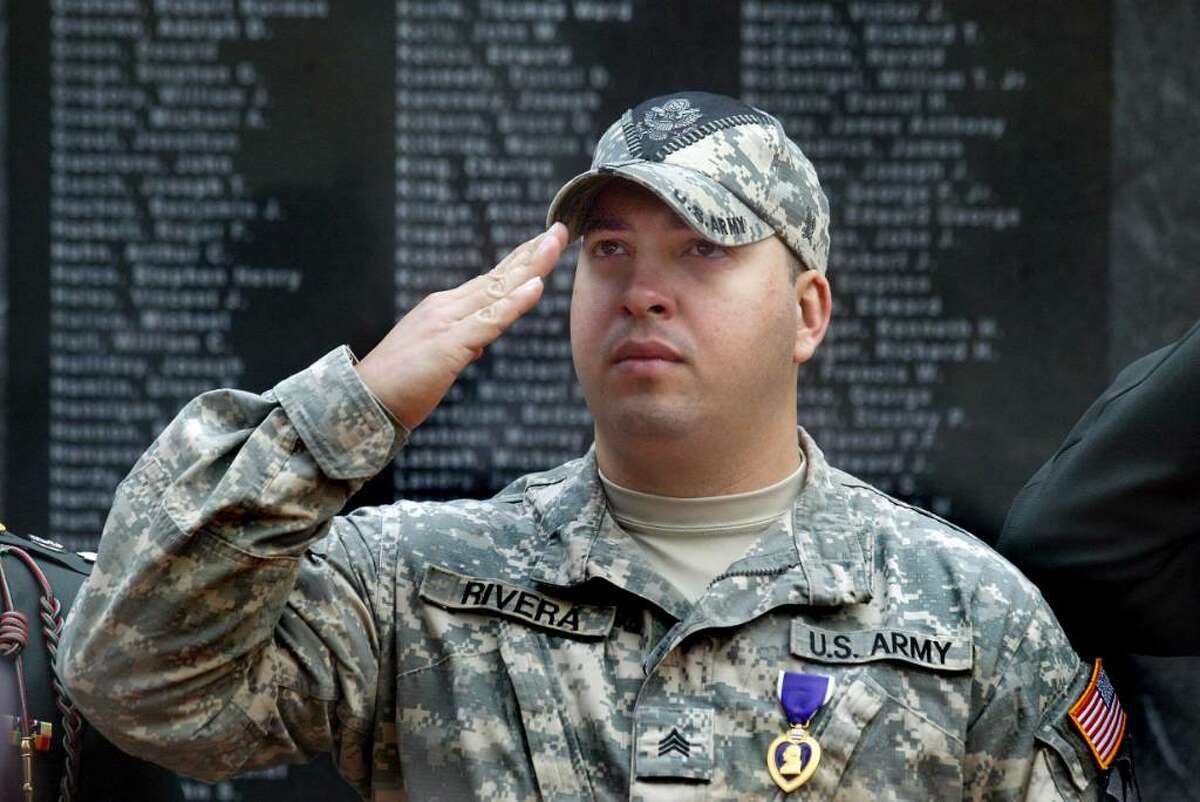 Bridgeport veteran, Sgt. Jose Rivera salutes during the McLevy Green Veterans Day Ceremony. Rivera, who fought in the Iraq War, was wounded 3 times and received the purple heart, Wednesday, Nov. 11, 2009.