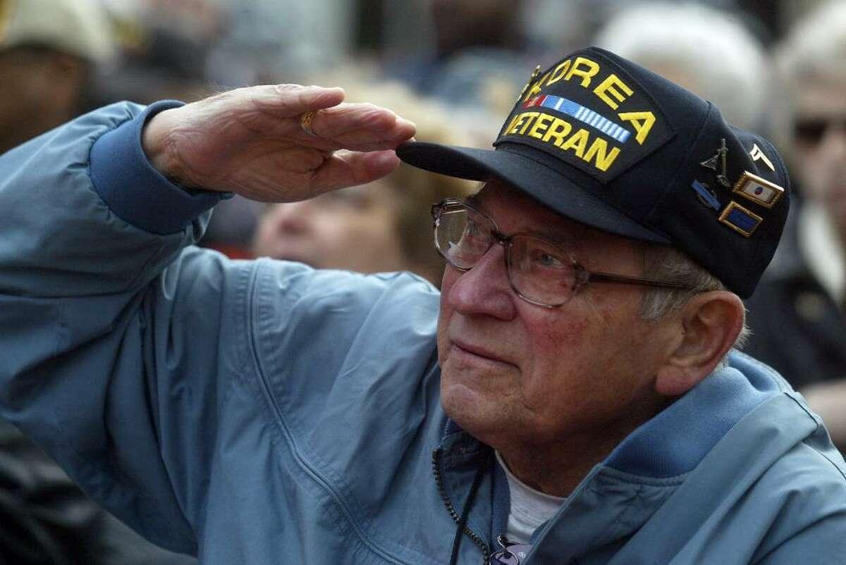 Korean War vet, Charles A. Rich salutes during the Veteran's Day, McLevy Green, ceremony focusing on the new Korean War memorial in Bridgeport Wednesday, Nov. 11, 2009.