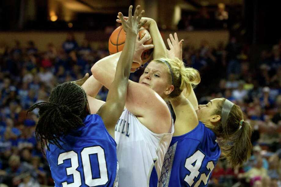 Barbers Hill center Kendall Shaw (35) is double-teamed by Mansfield Summit forward Jazzmin Jackson (30) and center Destiny Strange (42) during first half action in a class 4A semifinal game during the UIL girls state basketball tournament at the Frank Erwin Center on Thursday, March 1, 2012, in Austin. Photo: Smiley N. Pool, Houston Chronicle / © 2012  Houston Chronicle