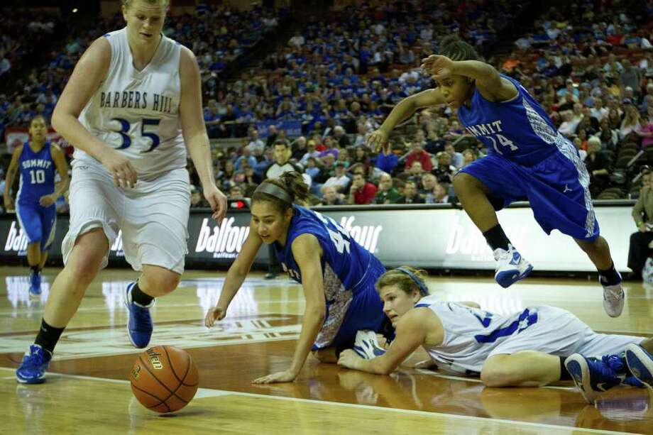 Mansfield Summit guard Nia Jackson (14) leaps over Barbers Hill guard/forward Kaylee Kana (23) as she chases a loose ball with Barbers Hill center Kendall Shaw (35) and Mansfield Summit center Destiny Strange (42) during first half action in a class 4A semifinal game during the UIL girls state basketball tournament at the Frank Erwin Center on Thursday, March 1, 2012, in Austin. Photo: Smiley N. Pool, Houston Chronicle / © 2012  Houston Chronicle