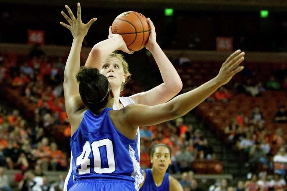 Barbers Hill center Kendall Shaw (35) shoots over Mansfield Summit center Tierra Brown (40) during second half action in a class 4A semifinal game during the UIL girls state basketball tournament at the Frank Erwin Center on Thursday, March 1, 2012, in Austin. Mansfield Summit won the game. Photo: Smiley N. Pool, Houston Chronicle / © 2012  Houston Chronicle
