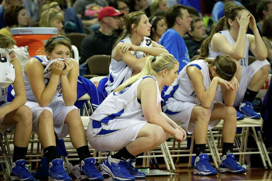 The Barbers Hill bench absorbs the final seconds of their loss to Mansfield Summit during second half action in a class 4A semifinal game during the UIL girls state basketball tournament at the Frank Erwin Center on Thursday, March 1, 2012, in Austin. Photo: Smiley N. Pool, Houston Chronicle / © 2012  Houston Chronicle