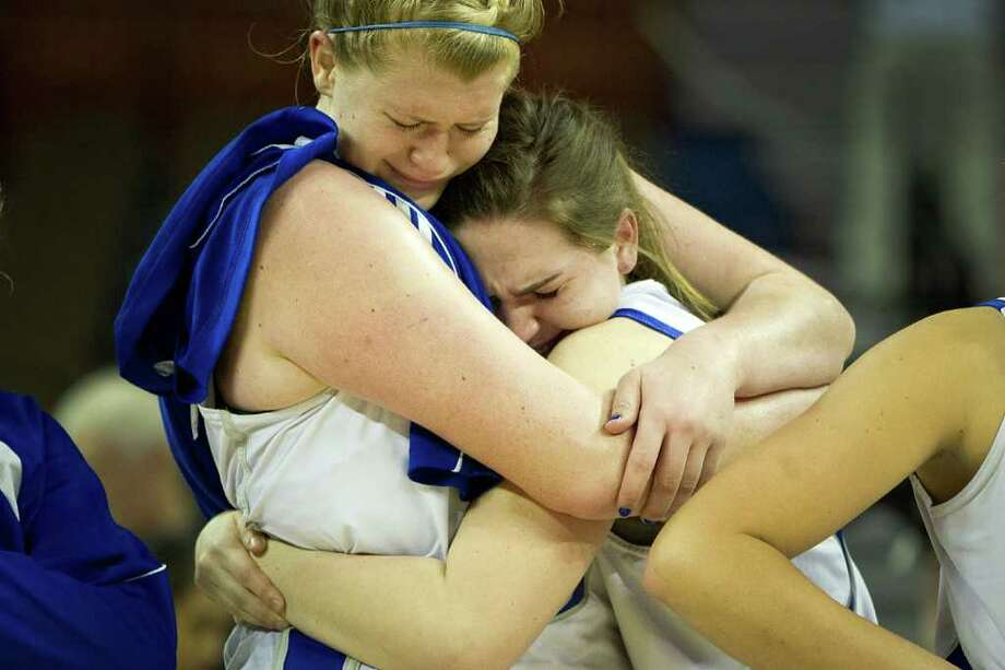 Barbers Hill center Kendall Shaw, left, hugs teammate Emily Storm after a loss to Mansfield Summit in a class 4A semifinal game during the UIL girls state basketball tournament at the Frank Erwin Center on Thursday, March 1, 2012, in Austin. Photo: Smiley N. Pool, Houston Chronicle / © 2012  Houston Chronicle