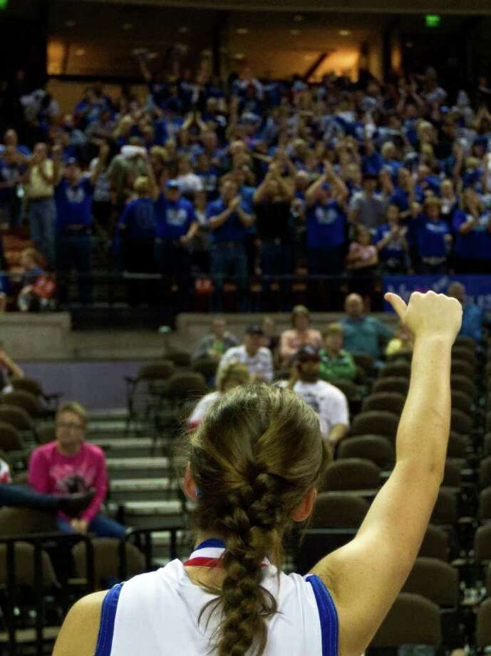 Barbers Hill guard Kimberlin Naivar waves to her team's supporters after a loss to Mansfield Summit in a class 4A semifinal game during the UIL girls state basketball tournament at the Frank Erwin Center on Thursday, March 1, 2012, in Austin. Mansfield Summit won the game. Photo: Smiley N. Pool, Houston Chronicle / © 2012  Houston Chronicle