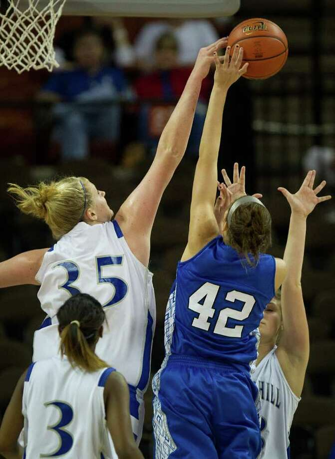 Barbers Hill center Kendall Shaw (35) blocks a shot by Mansfield Summit center Destiny Strange (42) during first half action in a class 4A semifinal game during the UIL girls state basketball tournament at the Frank Erwin Center on Thursday, March 1, 2012, in Austin. Photo: Smiley N. Pool, Houston Chronicle / © 2012  Houston Chronicle