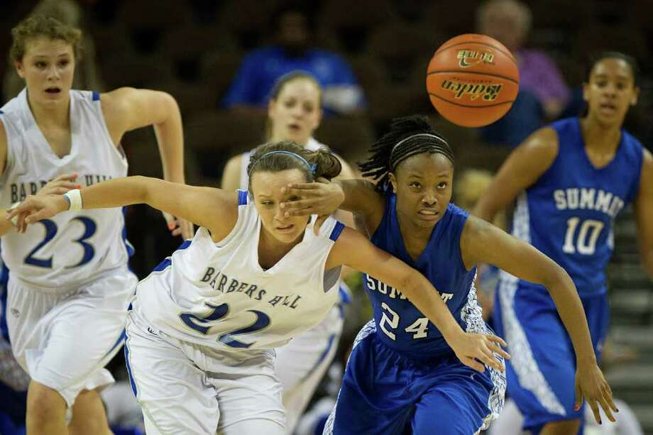 Barbers Hill guard Makenzi May (22) gets a hand in the face as she chases a loose ball against Mansfield Summit guard Shayna Jackson (24) during first half action in a class 4A semifinal game during the UIL girls state basketball tournament at the Frank Erwin Center on Thursday, March 1, 2012, in Austin. Photo: Smiley N. Pool, Houston Chronicle / © 2012  Houston Chronicle