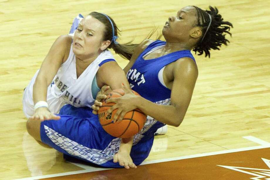 Barbers Hill guard Makenzi May (22) fights for a loose ball against Mansfield Summit guard Shayna Jackson (24) during first half action in a class 4A semifinal game during the UIL girls state basketball tournament at the Frank Erwin Center on Thursday, March 1, 2012, in Austin. Photo: Smiley N. Pool, Houston Chronicle / © 2012  Houston Chronicle