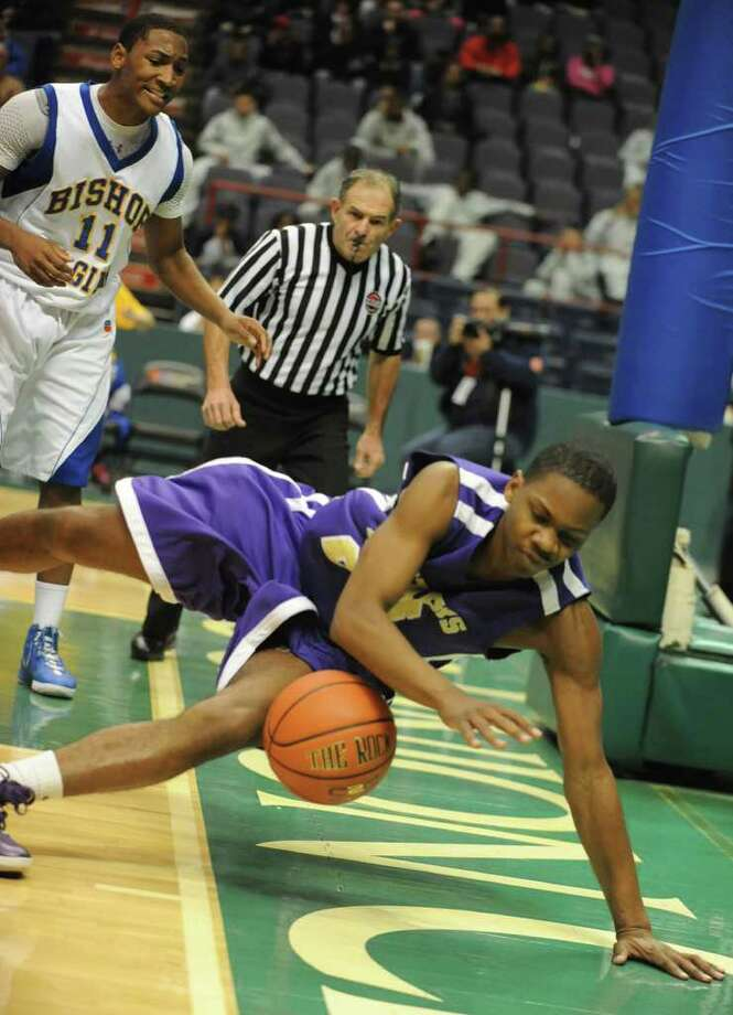 CBA's Cha Cancer tries to save the ball from going out of bounds during a basketball game against Bishop Maginn in a Class AA semifinals basketball game Thursday, March 1, 2012 in Albany, N.Y. (Lori Van Buren / Times Union) Photo: Lori Van Buren