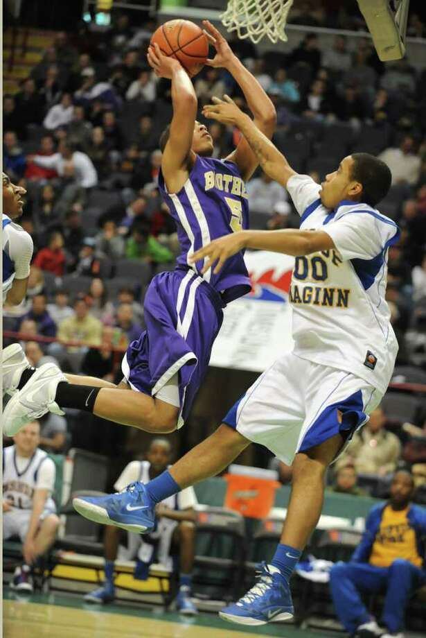 CBA's Christian Leppanen drives to the basket against Bishop Maginn's DeAndre Gibbs during a Class AA semifinals basketball game Thursday, March 1, 2012 in Albany, N.Y. (Lori Van Buren / Times Union) Photo: Lori Van Buren