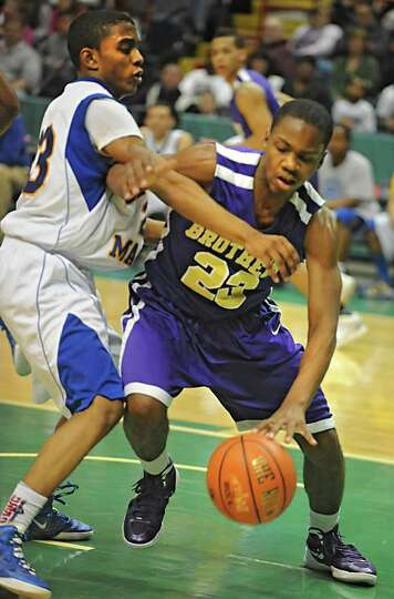 CBA's Sha Cancer drives to the basket against Bishop Maginn's Demere Hannah during a Class AA semifi