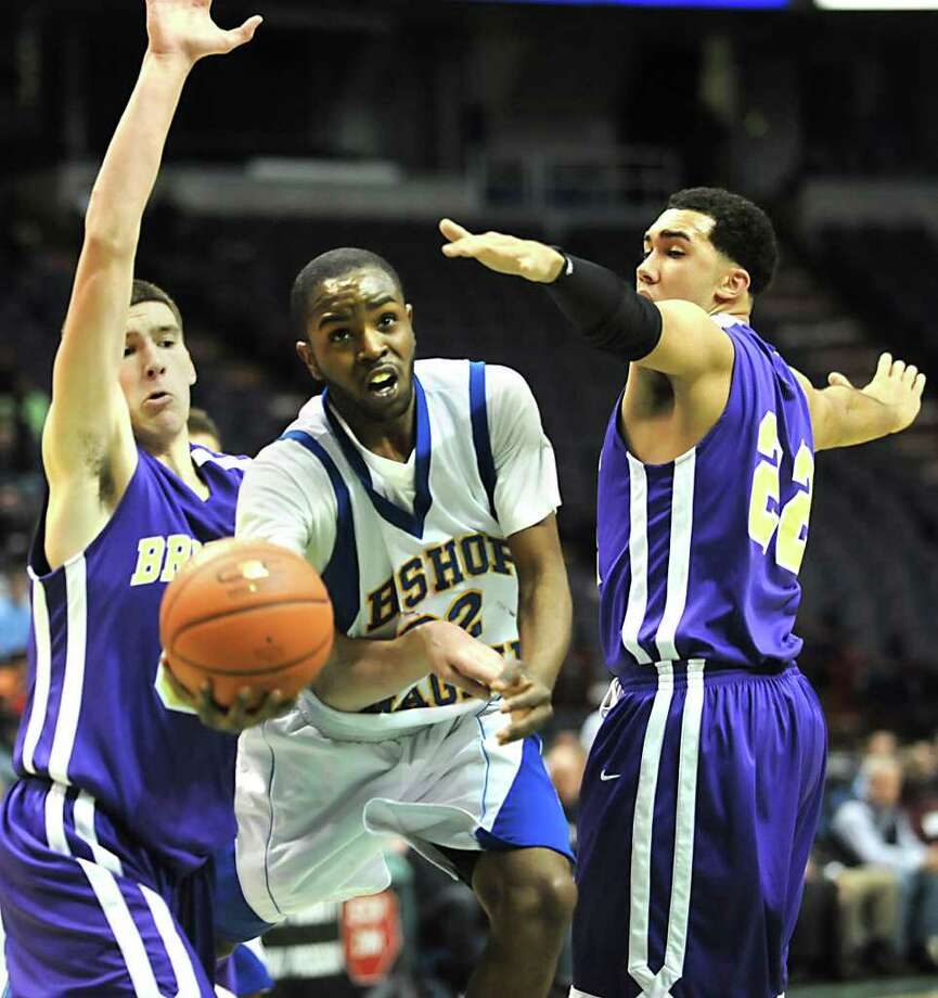 Bishop Maginn's J.R. Briceus is double teamed by CBA's Greig Stire, left, and Nate Robinson as he drives to the basket during a Class AA semifinals basketball game Thursday, March 1, 2012 at the Times Union Center in Albany, N.Y. (Lori Van Buren / Times Union) Photo: Lori Van Buren