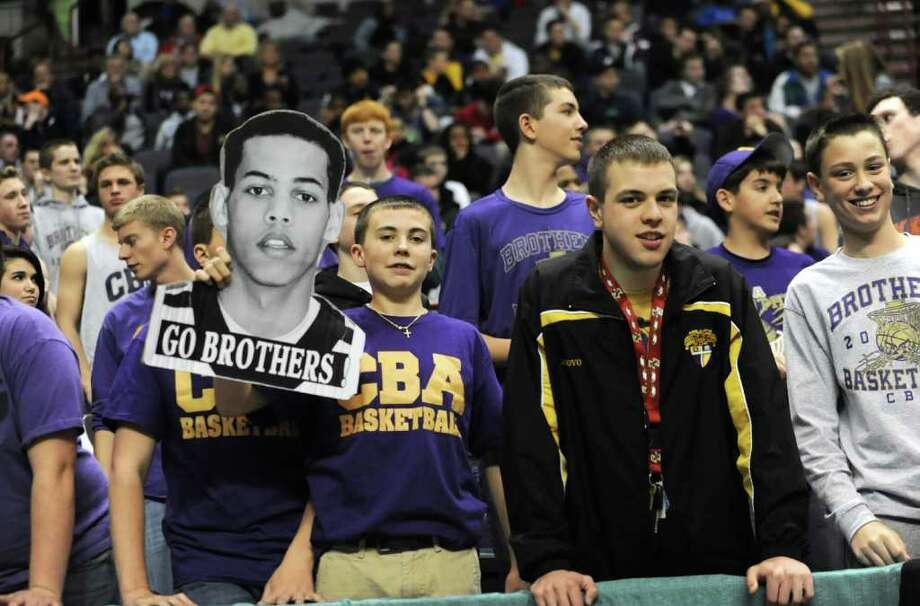 CBA fans watch a basketball game against Bishop Maginn in the Class AA semifinals Thursday, March 1, 2012 in Albany, N.Y. (Lori Van Buren / Times Union) Photo: Lori Van Buren