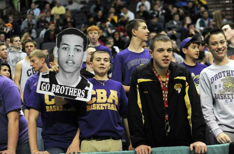 CBA fans watch a basketball game against Bishop Maginn in the Class AA semifinals Thursday, March 1,
