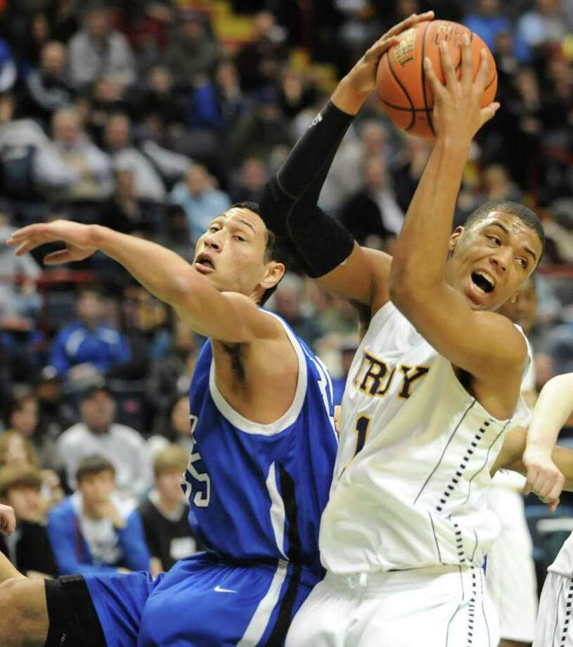 Troy's Jerrell Reid comes down with the rebound against Shaker's Casey Hall during a Class AA semifinals basketball game Thursday, March 1, 2012 at the Times Union Center in Albany, N.Y. (Lori Van Buren / Times Union) Photo: Lori Van Buren