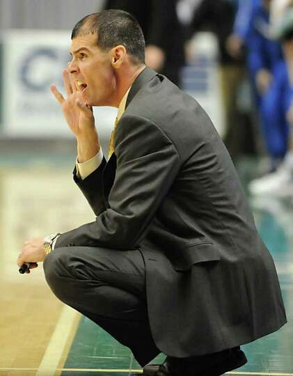 Troy head coach Richard Hurley screams from the sidelines during a basketball game against Shaker in