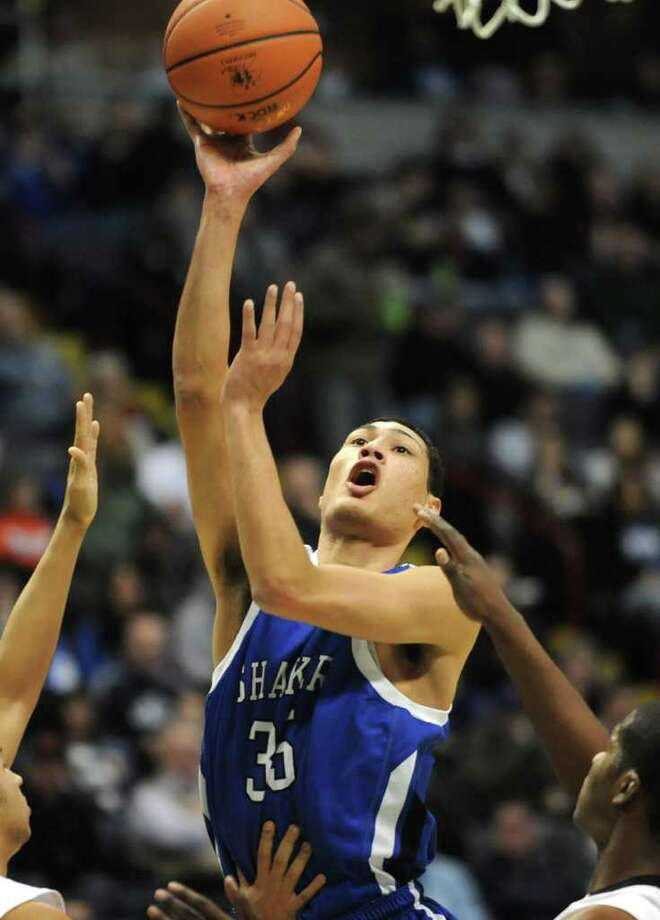 Shaker's Casey Hall goes up for two during a basketball game against Troy in the Class AA semifinals Thursday, March 1, 2012 in Albany, N.Y. (Lori Van Buren / Times Union) Photo: Lori  Van Buren