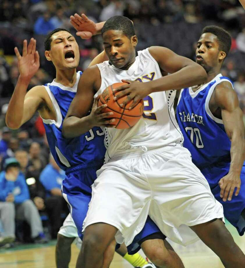 Troy's Rodney Burton drives to the basket against Shaker's Casey hall during a Class AA semifinals basketball game Thursday, March 1, 2012 at the Times Union Center in Albany, N.Y. (Lori Van Buren / Times Union) Photo: Lori Van Buren