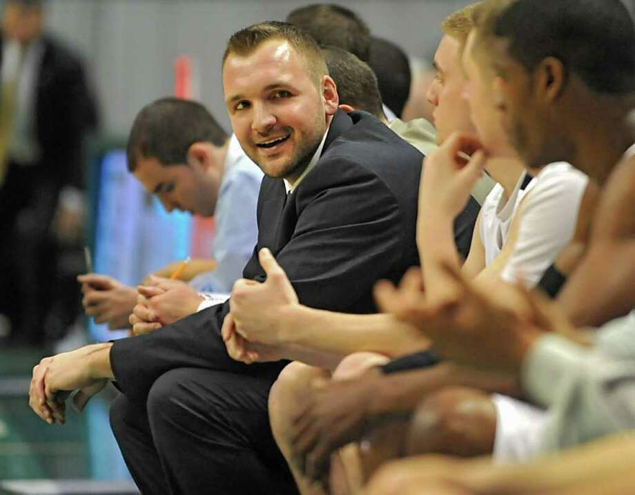 Troy assistant coach Jake Weaver talks to a player on the bench during a Class AA semifinals basketball game against Shaker Thursday, March 1, 2012 at the Times Union Center in Albany, N.Y. (Lori Van Buren / Times Union) Photo: Lori Van Buren