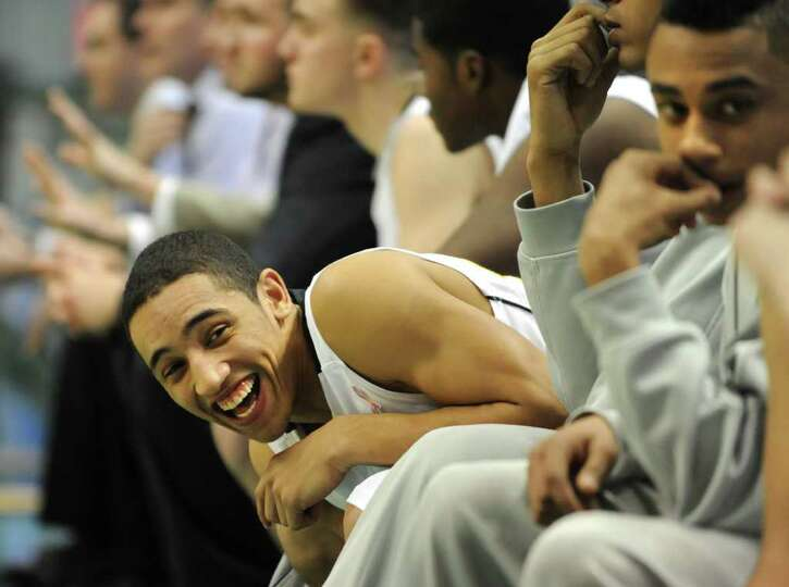 Troy's Daquan Holmes laughs on the bench during a Class AA semifinals basketball game against Shaker