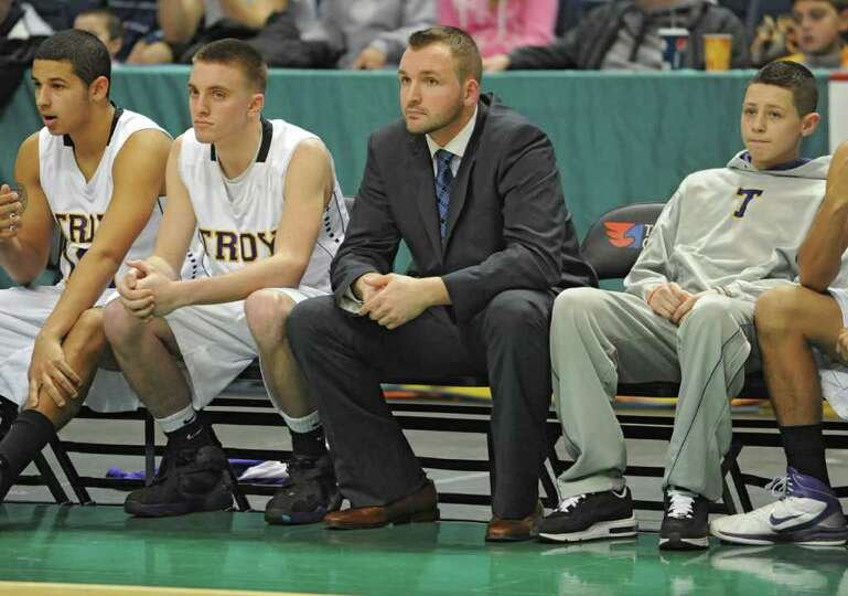 Troy assistant coach Jake Weaver watches the game on the bench during a Class AA semifinals basketba