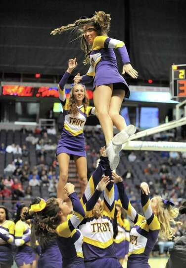 Troy cheerleaders perform during a basketball game against Shaker in the Class AA semifinals Thursda