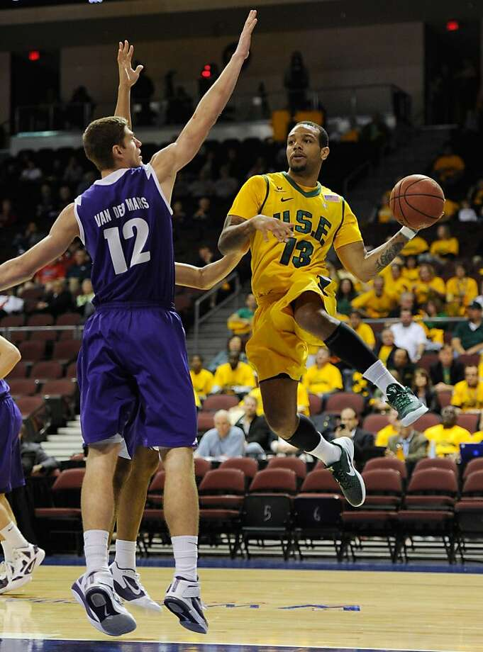 LAS VEGAS, NV - MARCH 01:  Rashad Green #13 of the San Francisco Dons passes around Thomas van der Mars #12 of the Portland Pilots during the second round of the Zappos.com West Coast Conference Basketball tournament at the Orleans Arena March 1, 2012 in Las Vegas, Nevada.  (Photo by Ethan Miller/Getty Images) Photo: Ethan Miller, Getty Images
