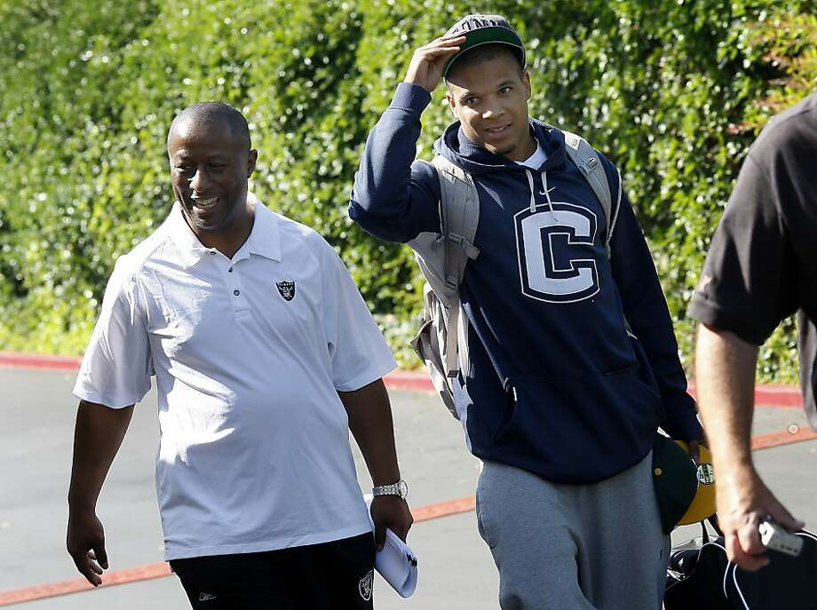 Tyvon Branch (right) walked from the parking lot to the hotel. The Oakland Raiders opened their training camp in Napa, Calif. Wednesday 27, 2011 after the labor dispute was solved recently. Photo: Brant Ward, The Chronicle