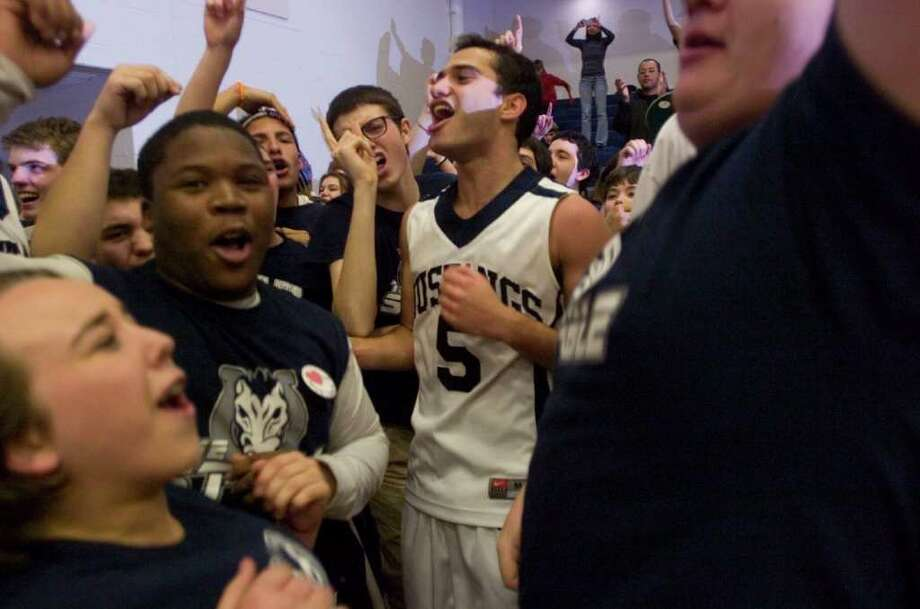 Immaculate's Marcos DeOliveira celebrates with the fans after their 64-53  SWC championship win against Notre Dame Fairfield at Weston High School on Thursday, March 1, 2012. Photo: Jason Rearick / The News-Times