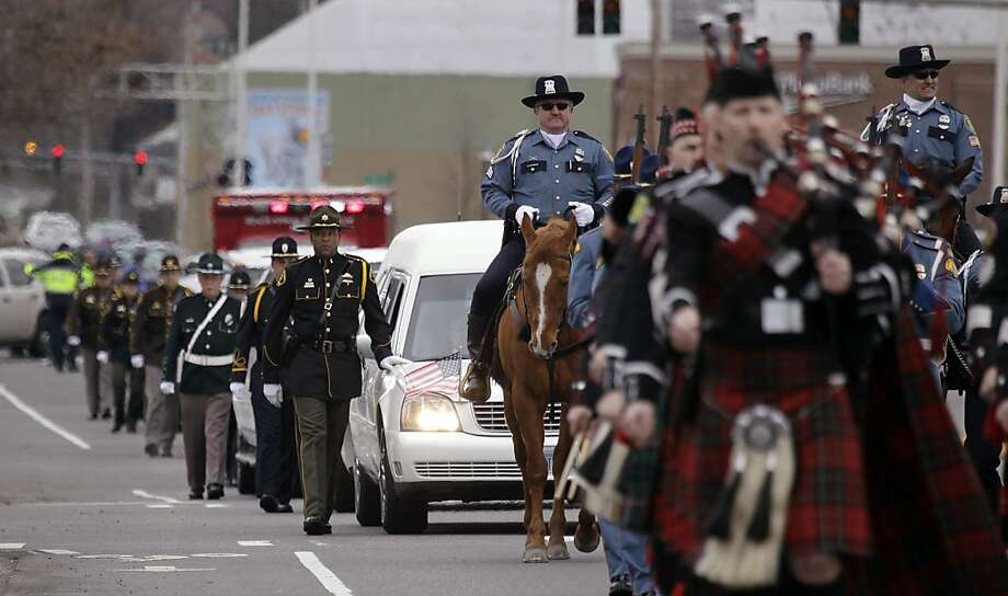 A procession arrives carrying the body of Washington State Trooper Tony Radulescu to a memorial service, Thursday, March 1, 2012, in Kent, Wash. Radulescu was shot and killed last week during a traffic stop in Gorst, Wash. (AP Photo/Elaine Thompson) Photo: Elaine Thompson, Associated Press