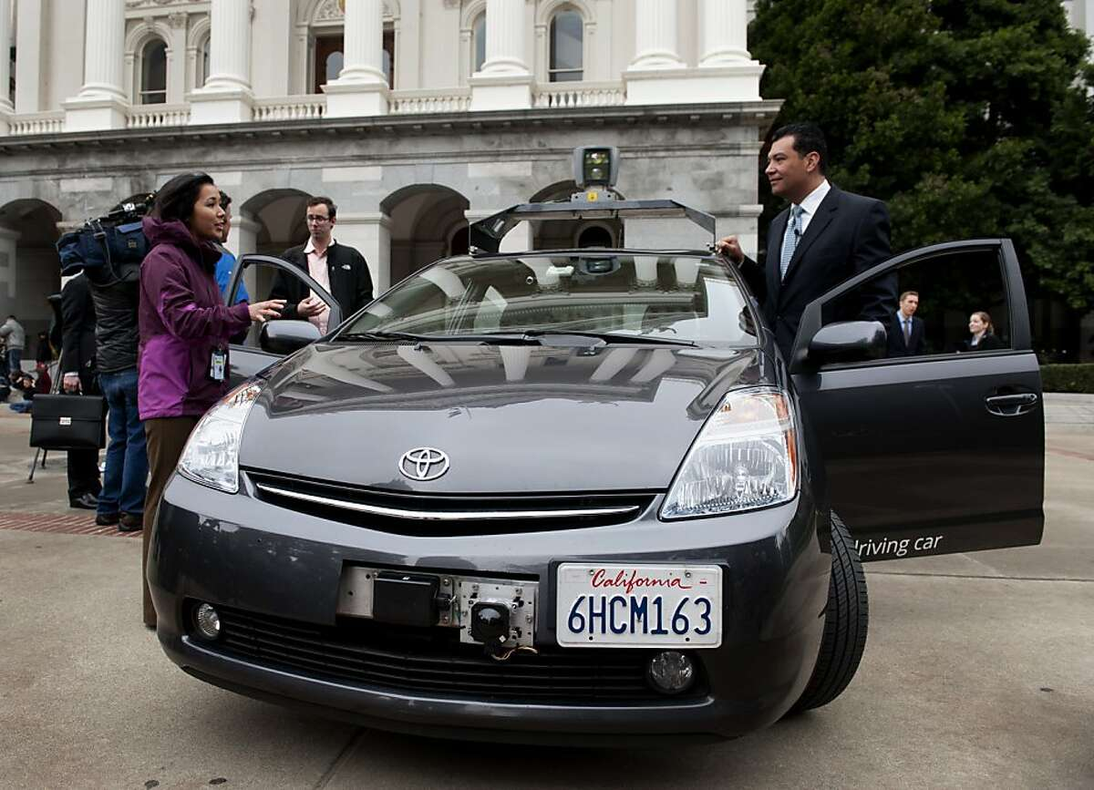 Sen. Alex Padilla (D-Pacoima) talks with a reporter after introducing Senate Bill 1298, which would establish guidelines for autonomous vehicles to be tested and operated in California during a press conference on the west steps of the Capitol March 1, 2012. He prepares to leave in Google's autonomous vehicle.