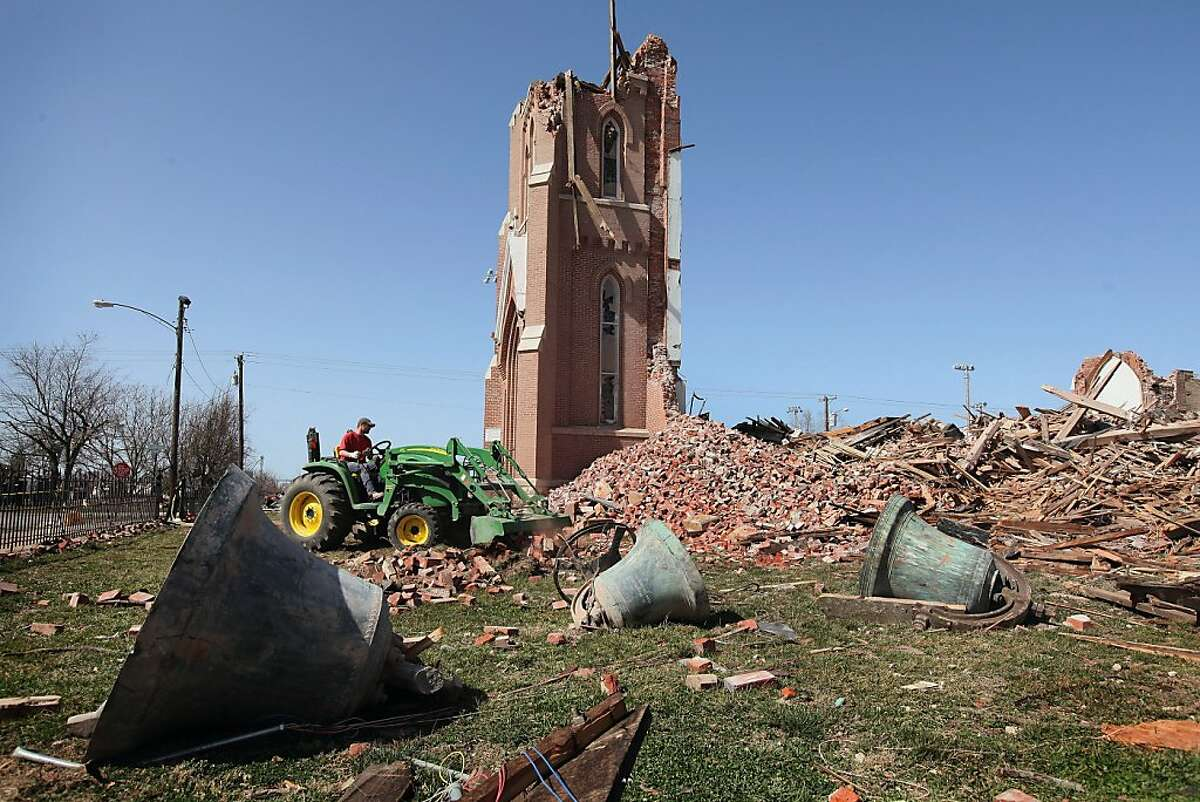 Parishioner Chad Wargel clears debris from the grounds of St. Joseph's Catholic Church on March 1, 2012 in Ridgeway, Illinois. The 110-year-old church was completely destroyed after it was struck by a tornado early Tuesday morning. According to reports, at least 13 people died as severe weather swept through the middle of the country on Tuesday.