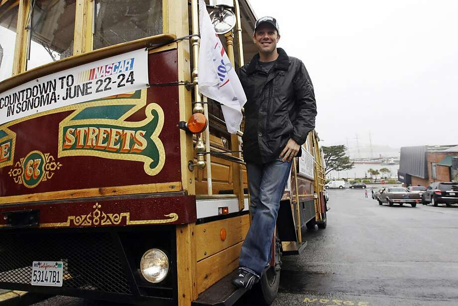 Daytona 500 winner Matt Kenseth poses for photographs on a replica cable car, Thursday, March 1, 2012, in San Francisco. (AP Photo/Marcio Jose Sanchez) Photo: Marcio Jose Sanchez, Associated Press