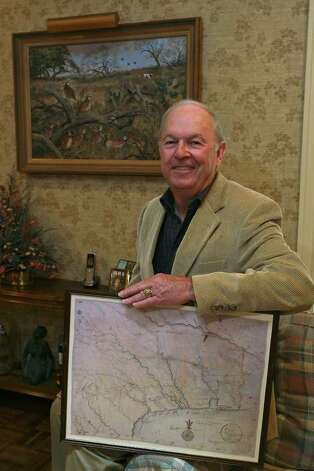 Robert P. Marshall with a reproduction of an 1822 map by Stephen F. Austin. He believes he's located the site of the Battle of Medina. Photo: Jerry Lara, San Antonio Express-News / © San Antonio Express-News