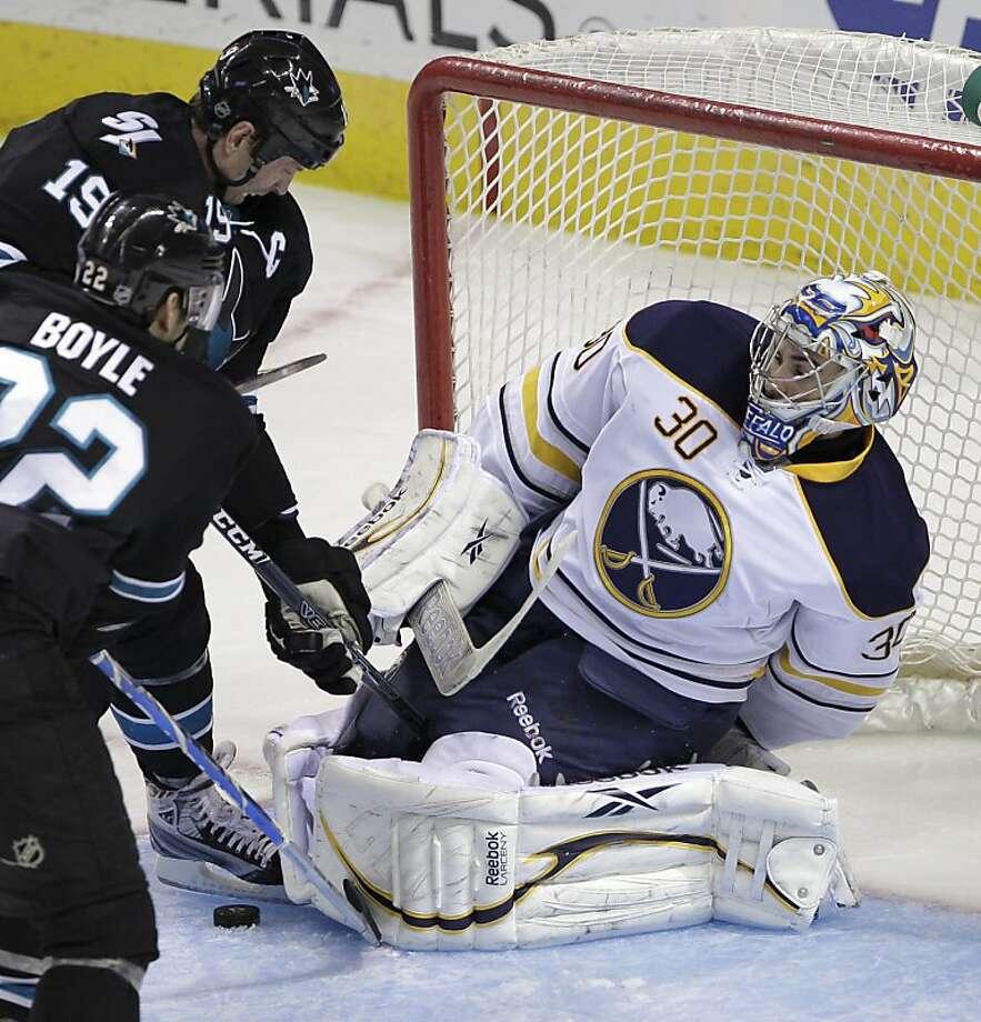 San Jose Sharks center Joe Thornton (19) is unable to score past Buffalo Sabres goalie Ryan Miller (30) during the second period of an NHL hockey game in San Jose, Calif., Thursday, March 1, 2012. (AP Photo/Paul Sakuma) Photo: Paul Sakuma, Associated Press