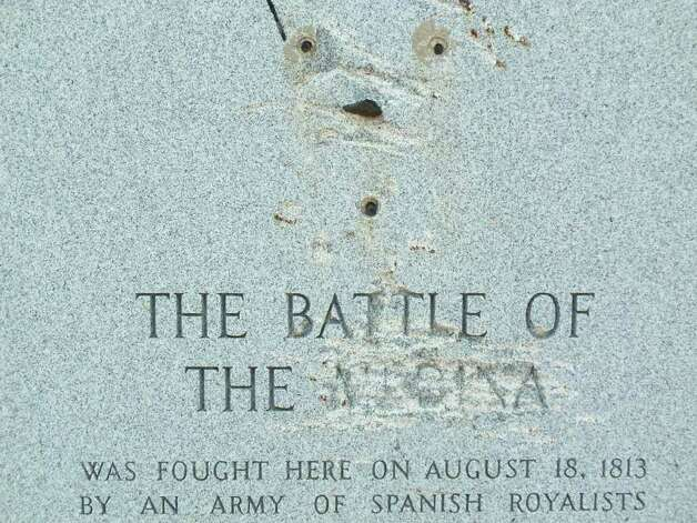 "The state's 1936 Battle of Medina marker at the southeast corner of U.S. 281 South and Martinez Losoya Road has been badly defaced. The word ""Medina"" has been scratched out, and the bronze wreath and star removed. Historians now believe the marker may be about six miles north of the site of the heaviest fighting from the Aug. 18, 1813 battle — the deadliest in Texas history. Photo: Scott Huddleston, San Antonio Express-News"
