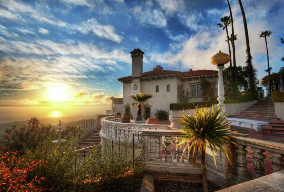 Over a period of several decades, from 1919 to 1947, William Randolph Hearst worked with architect Julia Morgan to create a palatial mansion on his property in San Simeon, CA. Now known as Hearst Castle, the estate includes 165 rooms and 127 acres of gardens, terraces, pools, and walkways. In 1957, Hearst Castle was donated to the state of California, and it has been maintained as a state park ever since. Photo: Trey Ratcliff, Courtesy Hearst Castle®/California State Parks. / Courtesy Hearst Castle®/California State Parks.