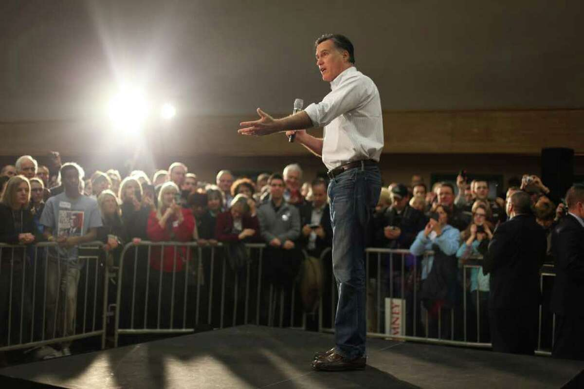 U.S. presidential candidate Mitt Romney addresses supporters at Highland Park Community Center on Friday, March 2, 2012 in Bellevue. Romney made the appearance one day before Saturday's Republican caucus to decide the nominee for president.