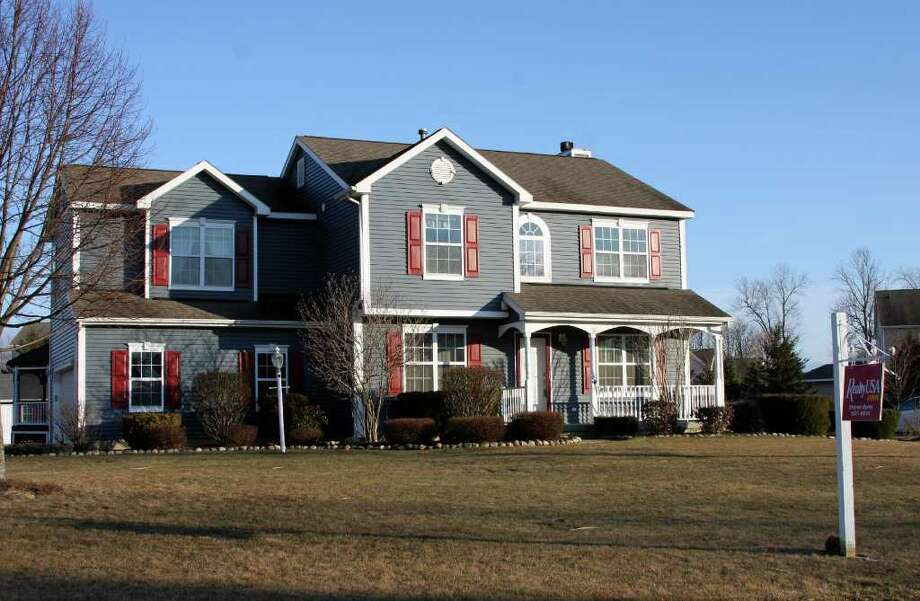 Michael Lisi This 2,095-square-foot Colonial with four bedrooms, 2.5 bathrooms, and an attached two-car garage at 6 Swan Drive in Clifton Park?s Somerset neighborhood is on the market for $339,900.