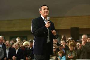 Dino Rossi addresses supporters of U.S. presidential candidate Mitt Romney at Highland Park Community Center on Friday, March 2, 2012 in Bellevue.