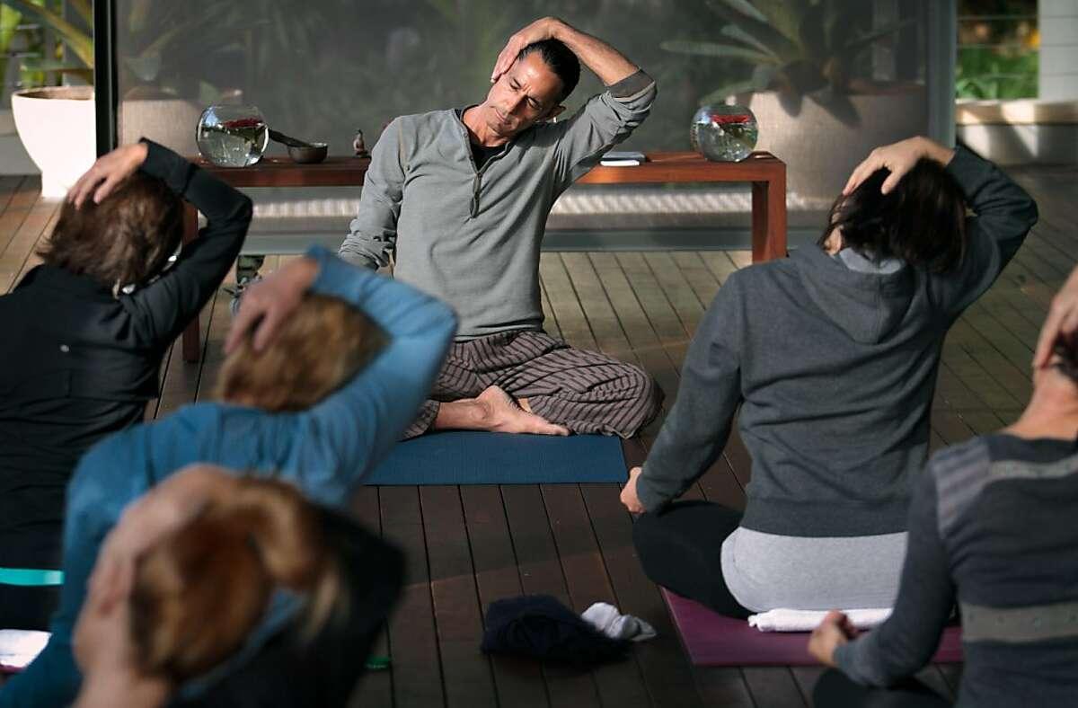 Sheldon Leon teaches yoga at the Byron at Byron Bay resort in Byron Bay, Australia.