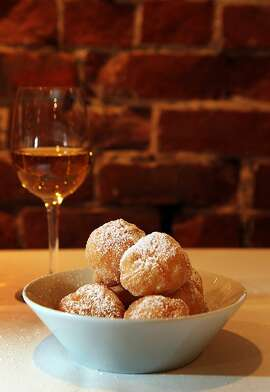 Beignets are offered at Piperade restaurant on San Francisco's Battery St. Tuesday, February 14, 2012.