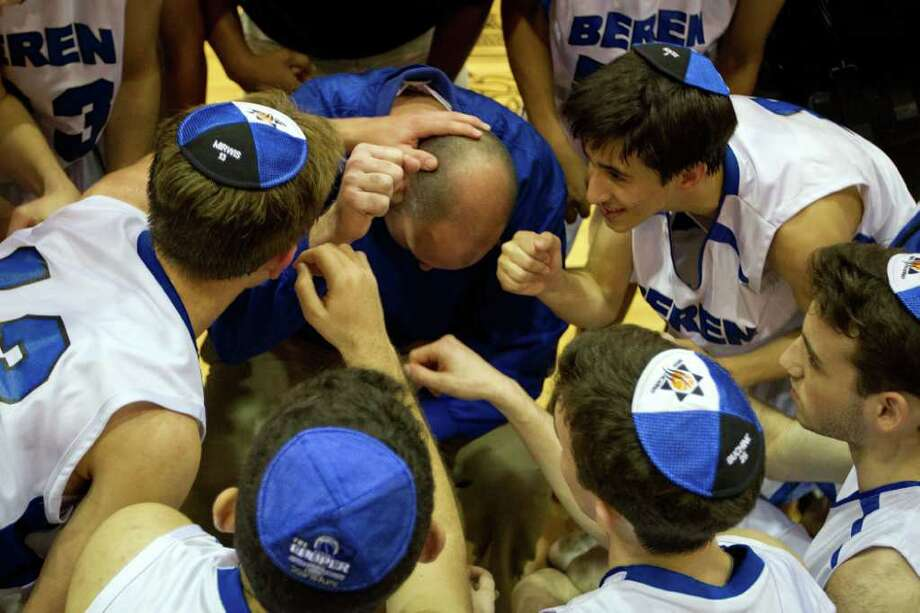 Beren Academy players huddle around coach Chris Cole in the final moments of the Stars victory over Dallas Covenant in a TAPPS 2A state semifinal basketball game at Nolan Catholic High School on Friday, March 2, 2012, in Fort Worth.  Beren originally forfeited the game because it interfered with observance of the Jewish Sabbath. After a lawsuit, the time and location of the game was changed. Beren won the game 58-46 to advance to the championship. Photo: Smiley N. Pool, Houston Chronicle / © 2012  Houston Chronicle