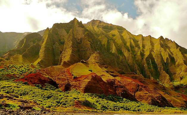 The green-corrugated cliffs of Kauai's Na Pali coast near the ancient fishing village of Nualolo Kai  Photo by John Flinn / Special to The Chronicle Photo: John Flinn